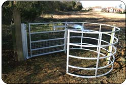 Disabled access Galvanised kissing gate and Slotted concrete post fencing with 12 inch tall gravel board before picture